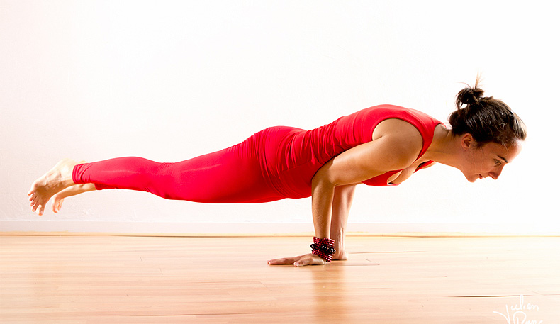 Peacock Pose - yoga poses for women